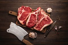 Meat steaks on board royalty free stock photos