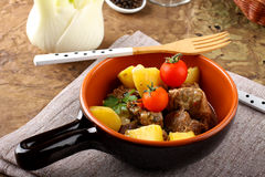 Meat stew with boiled potatoes and tomato Royalty Free Stock Photography
