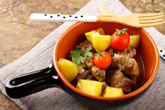 Meat stew with boiled potatoes and tomato Royalty Free Stock Images