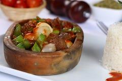 Meat stew in ceramic hot pot Stock Image