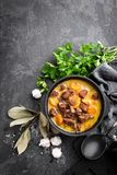 Meat stew, goulash in a cast iron pot Stock Photos