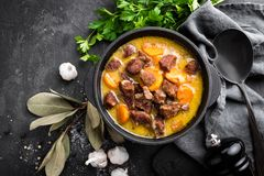 Meat stew, goulash in a cast iron pot Stock Image