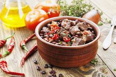 Meat stew with red beans and chili Stock Photo