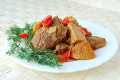 Meat stewed with cepes Stock Images