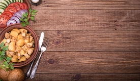 Meat stewed with potatoes in bowl . Stock Photography