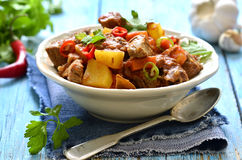 Meat stewed with vegetable in spicy tomato sauce. Stock Photography