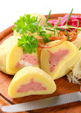 Meat stuffed potato dumplings with shredded cabbage Stock Images