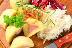 Meat stuffed potato dumplings with shredded cabbage royalty free stock photography