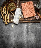 Meat stuffing with spices and herbs on a wooden board. On a rustic background Royalty Free Stock Photos