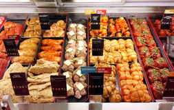 Meat in supermarket. Selection of different cuts of fresh raw meat and ready-to-cook meals in a supermarket Stock Photography