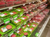 Meat in supermarket. Shelves of meat products in Dutch supermarket Stock Photo