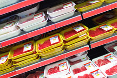 Meat at the supermarket. A view from several meat packages at supermarket shelves royalty free stock image