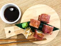 Meat sushi rolls with beef. Studio Photo Royalty Free Stock Photography