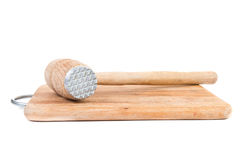 Meat tenderizer and board Royalty Free Stock Image