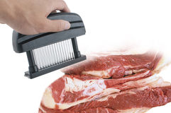 Meat tenderizer device and fresh meat Stock Photo