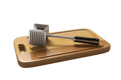 Meat Tenderizer on wooden board.  on white background Stock Photography