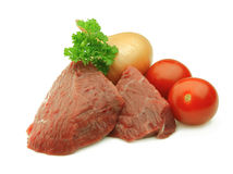 Meat and  tomato Stock Photos