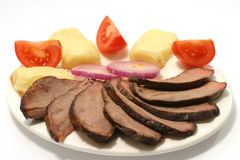 Meat tomato and potato. Roast beef with tomato and potato Stock Photos