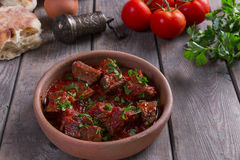 Meat in tomato sauce beef roast in a clay bowl. Meat in tomato sauce beef roast in clay bowl stock image