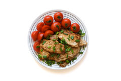 Meat with tomatoes. Fried meat with tomatoes on a plate Stock Photography