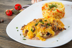 Meat under cheese and mushrooms with rice Royalty Free Stock Image