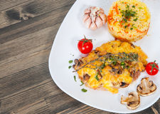Meat under cheese and mushrooms with rice Stock Image
