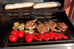 Meat and vegetable on BBQ Stock Images