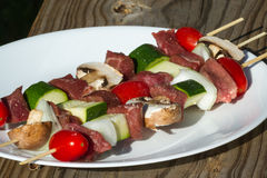 Meat and vegetable skewers Royalty Free Stock Images