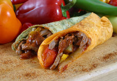 Meat and vegetable wrap. With elk meat royalty free stock photography