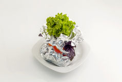 Meat with vegetables baked in aluminum foil Stock Photo