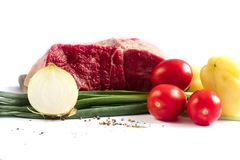 Meat with vegetables beef tomatoes parsley royalty free stock images
