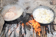 Meat and vegetables boil in two cauldrons on fire. In the countryside of Giron on Cuba royalty free stock photo