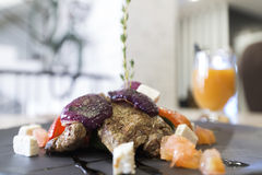 Meat with vegetables and cheese in restaurant Stock Photos