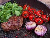 Meat and vegetables in frying pan Royalty Free Stock Images