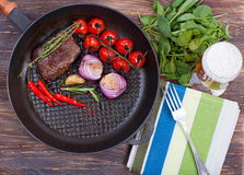 Meat and vegetables in frying pan Stock Photo