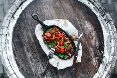 Meat and vegetables in a frying pan stock images
