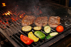 Meat and vegetables on grill Stock Image