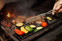 Meat and vegetables on grill Royalty Free Stock Photo