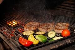 Meat and vegetables on grill Stock Photo