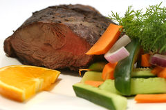 Meat vegetables and lemon. On dish Stock Photo