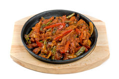 Meat and vegetables at pan Royalty Free Stock Image