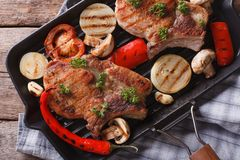 Meat with vegetables in a pan grill closeup. Top view horizontal Stock Photo