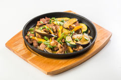 Meat and vegetables in the pan Stock Photo