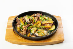 Meat and vegetables in the pan Royalty Free Stock Image