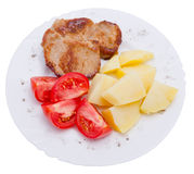 Meat and vegetables on plate. Isolated on white background stock image
