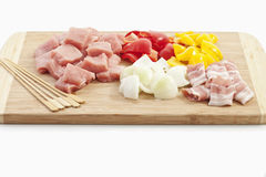 Meat and vegetables for preparing meat skewer, close up Royalty Free Stock Images