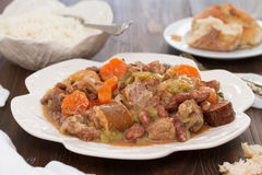 Meat with vegetables and sausages on plate Stock Image