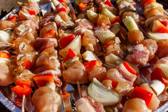 Meat and vegetables shashliks on grill. Royalty Free Stock Images