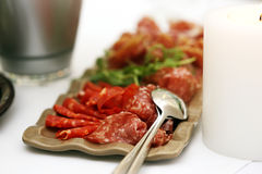 Meat with vegetables. Slices of meat with some vegetables on a table Royalty Free Stock Photography