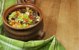 Meat and vegetables with sour cream and green celery  in a pot Stock Images